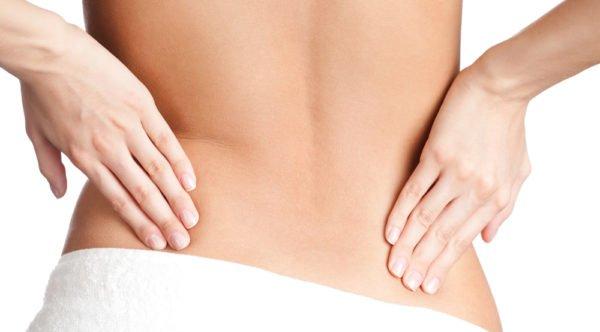 Напряжение мышц внизу спины