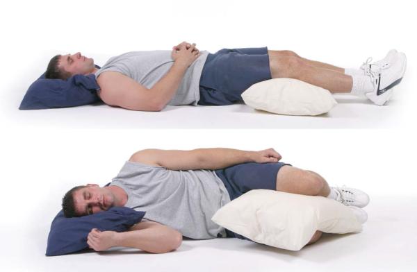 В состоянии покоя, лежа на спине или боку, боль уменьшается
