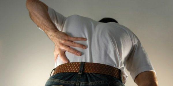 Боль в спине при наклоне