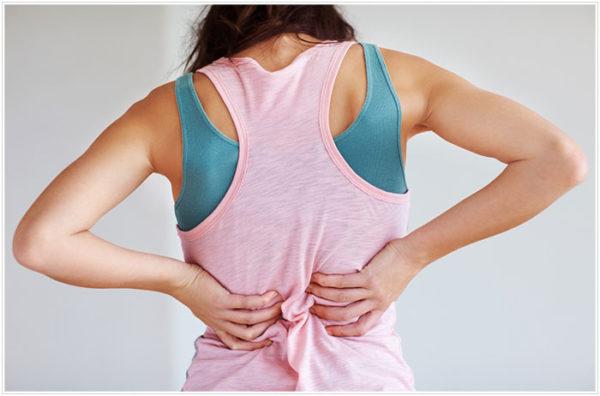 Сколиоз второй степени характеризуется тянущими болями в пояснице