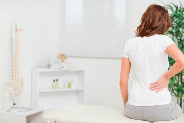 Боль в спине при месячных