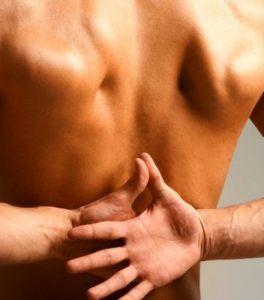 Болит позвоночник посредине спины